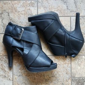 Black high heeled ankle booties with buckles